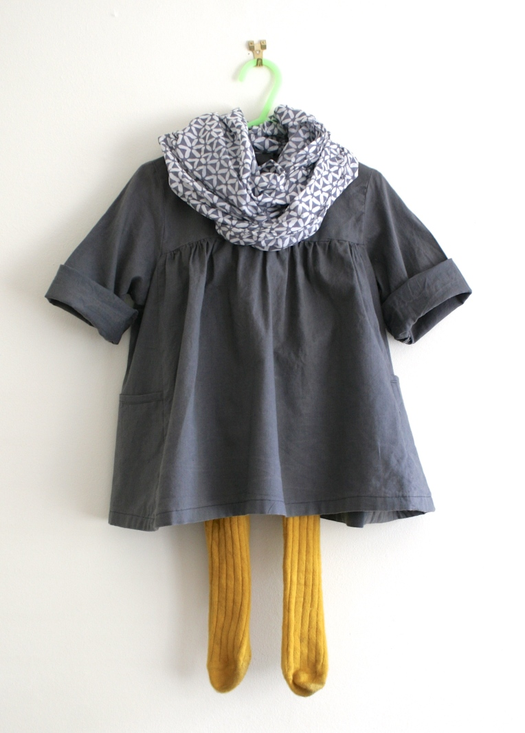 home sewn toddler smock dress in grey cotton with contrast buttons
