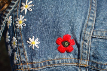 embroidered flowers on denim